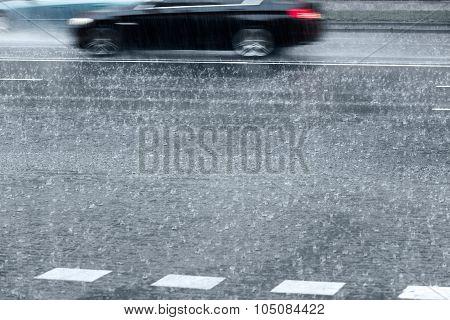 Blurred Cars On Rainy Street