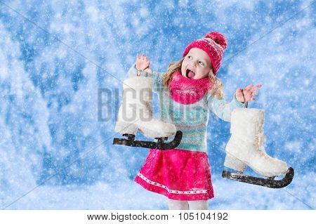 Little Girl Having Fun At Ice Skating In Winter