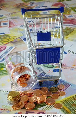 Blue Shopping Cart And Coin Stack