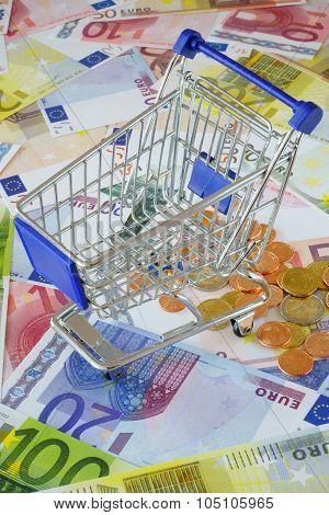 Blue Shopping Cart On Money