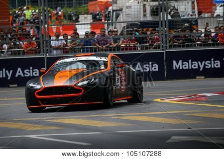 KUALA LUMPUR, MALAYSIA - AUGUST 08, 2015: Gerard Yap drives a Vantage N24 GT4 car takes turn 2 in the KL City GT CUP Race of the 2015 Kuala Lumpur City Grand Prix.