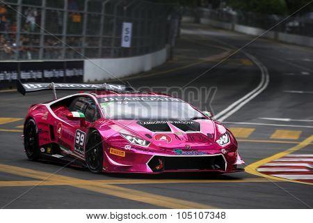 KUALA LUMPUR, MALAYSIA - AUGUST 08, 2015: Naoki Yokomizo drives a Lamborghini Huracan Super Trofeo LP620 car on the city streets in the KL City GT CUP Race of the 2015 Kuala Lumpur City Grand Prix.