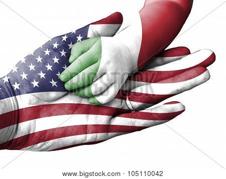 Adult Man Holding A Baby Hand With United States And Italy Flags Overlaid. Isolated On White