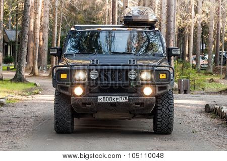 Black Hummer H2 Vehicle Goes On Dirty Country Road