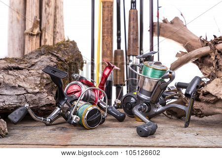 Fishing Reels And Rods With Boards And Snag