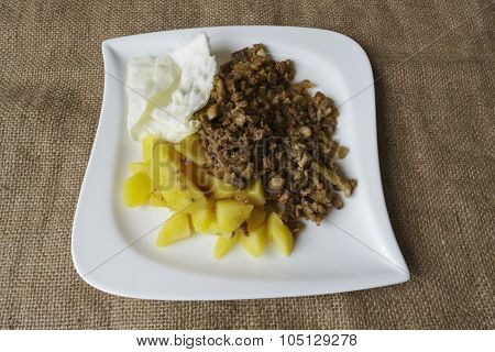 Photo taken  in Jablonec nad Nisou Czech Republic sliced potatoes soy granules leaf cabbage white plate poster