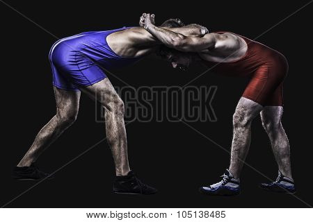 Two wrestlers holding each other in stand isolated