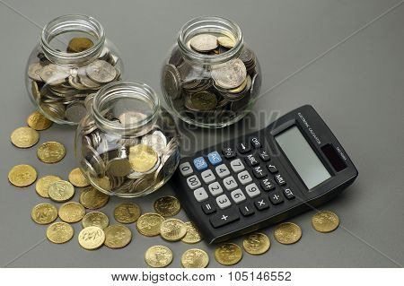 Coins With Calculator. Financial Concept