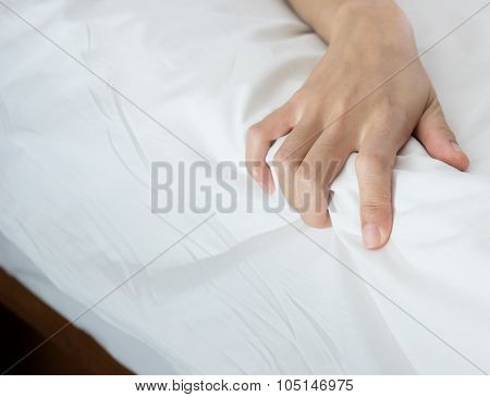 Woman Hand Grasp Bed Sheet