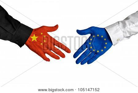 China and European Union leaders shaking hands on a deal agreement