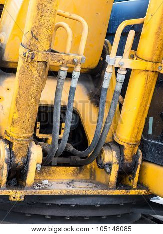 Hydraulic pipe of the old excavator in construction site. poster