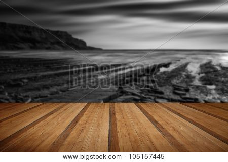 Beautiful Black And White Landscape Of Rocky Shore At Sunset With Wooden Planks Floor