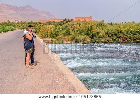 Tourists photographing Draa River, Morocco