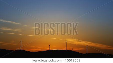 Wind Turbines On Sunset