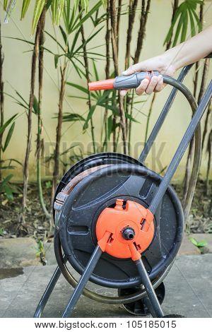 Prepare Watering Plant In The Garden