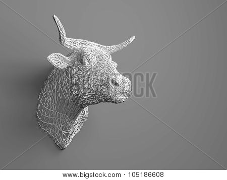 Artificial bull's head hanging on the wall. Polygonal head of a bull. Cows from the three-dimensiona
