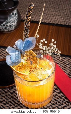 Alcoholic Cocktail In A Sushi Restaurant On A Dark Desk