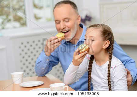 Grandfather and little girl having tea party