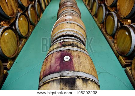 Wooden Wine Barrels In A Wine Cellar