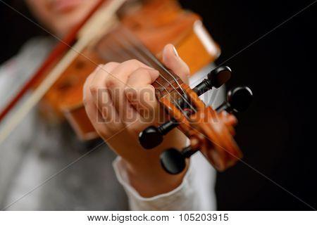 Nice girl playing the violin
