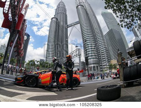 KUALA LUMPUR, MALAYSIA - AUGUST 09, 2015: The Lamborghini car of drivers Anthony Liu and Davide Rizzo make a pit stop in the Lamborghini Blancpain Super Trofeo Race of the 2015 KL City Grand Prix.