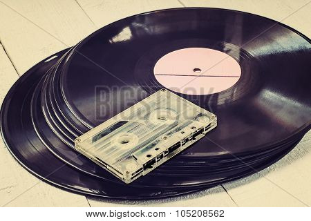 Old Vinyl Records And Audiocassette. Toned Photo
