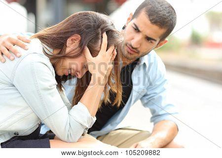 Man Comforting A Sad Girl Mourning