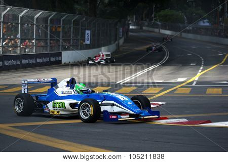 KUALA LUMPUR, MALAYSIA - AUGUST 09, 2015: Nicholas Rowe in a single seater racing car race in the city street circuit in the Formula Masters China Series Race at the 2015 Kuala Lumpur City Grand Prix.