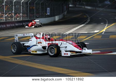 KUALA LUMPUR, MALAYSIA - AUGUST 09, 2015: Single seater racing cars race in the city street circuit in the Formula Masters China Series Race at the 2015 Kuala Lumpur City Grand Prix.