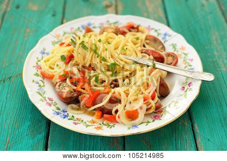 Spaghetti Al Pomodoro In White Plate With Fork On Wooden Turquoise Table Top View