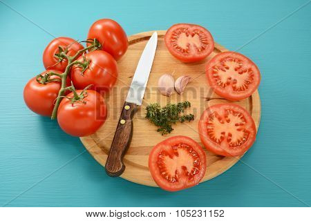 Tomatoes Cut For Roasting With Knife, Garlic And Thyme