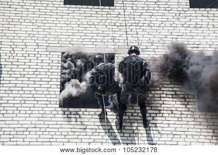 Spec ops police officer SWAT during assault operation poster
