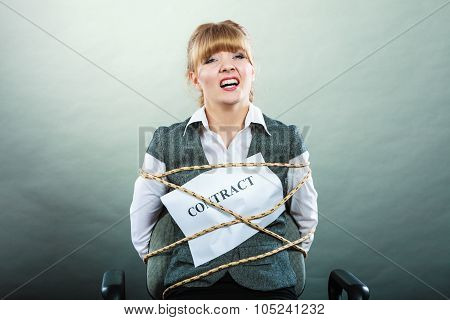 Afraid businesswoman bound by contract terms and conditions. Screaming scared woman tied to chair becoming slave. Business and law concept. poster