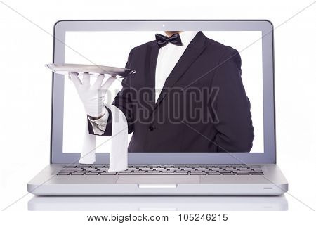 Waiter hand holding a silver tray through a laptop, isolated on white background