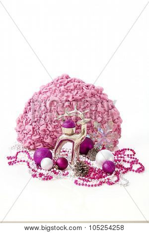 Christmas still-life with reindeer, ornaments in rose and violet colour.