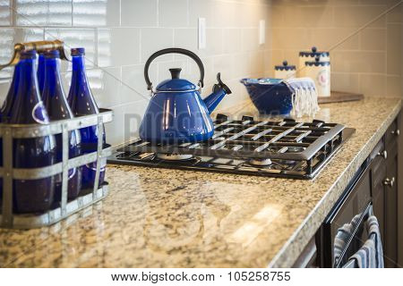 Beautiful Marble Kitchen Counter and Stove With Cobalt Blue Decor.