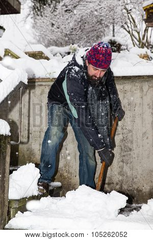 Man Is Snow Shoveling The Stairs