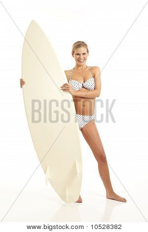Portrait of young woman holding surfboard