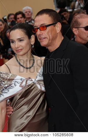 CANNES, FRANCE - MAY 15: Jean-Claude Van Damme and Gladys Portugues   attend the 'You Will Meet A Tall Dark Stranger'  the Palais  during the 63rd Cannes  Festival on May 15, 2010 in Cannes, France