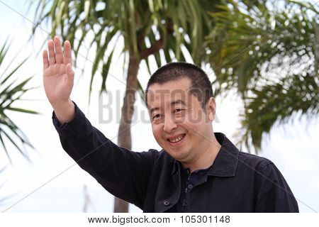 CANNES, FRANCE - MAY 17: Director Jia Zhangke attends 'Tian Zhu Ding' (A Touch Of Sin) photocall during the 66th Cannes Film Festival at the Palais des Festivals on May 17, 2013 in Cannes, France.