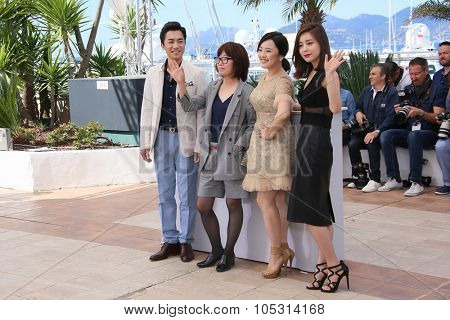 Actor Kim Young-Min, director Shin Su-Won and singer Kwon So-Hyun attend the 'Madonna' Photocall during the 68th annual Cannes Film Festival on May 20, 2015 in Cannes, France.