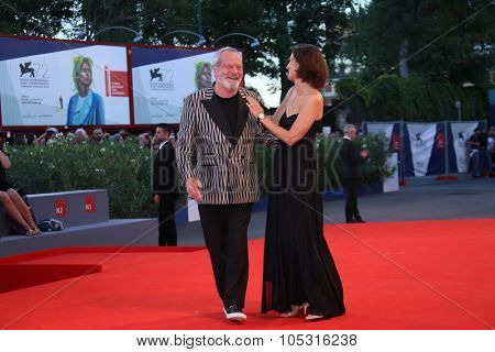 Terry Gilliam and Dorothee Eloy attend a premiere for 'A Bigger Splash' during the 72nd Venice Film Festival at Sala Grande on September 6, 2015 in Venice, Italy.