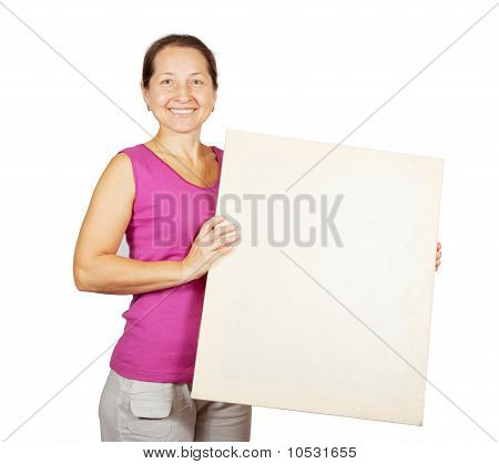 Mature Woman Holds Blank Canvas