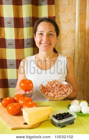 Woman With Food Products For Farci Tomato
