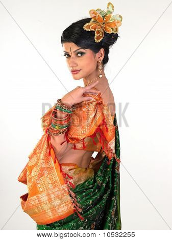 Woman in sari with side posture