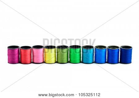 Sewing threads multicolored at white background