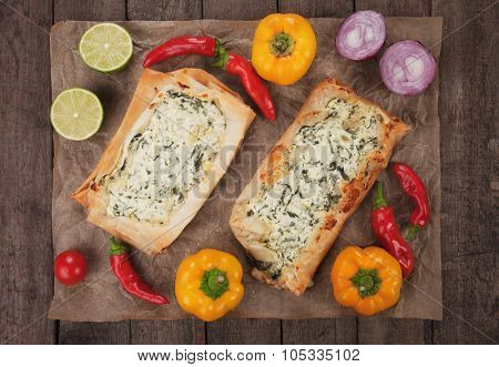 Phyllo pastry filled with cheese and spinach filling, traditional balkans fast food meal
