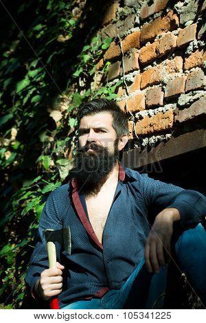 Man With Ax Near Wall