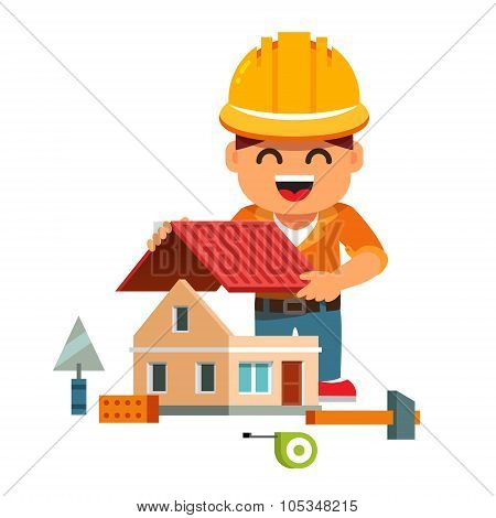 Young house builder in hardhat building home