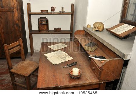 historic cloister writing room with old pergaments and writing tools real human skull poster